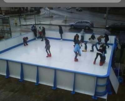 people doing skating in a skating rink